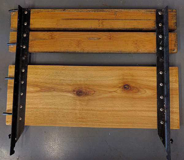 The first cedar board is attached to the Kamado Joe side shelf frame.  Now on to the next board.