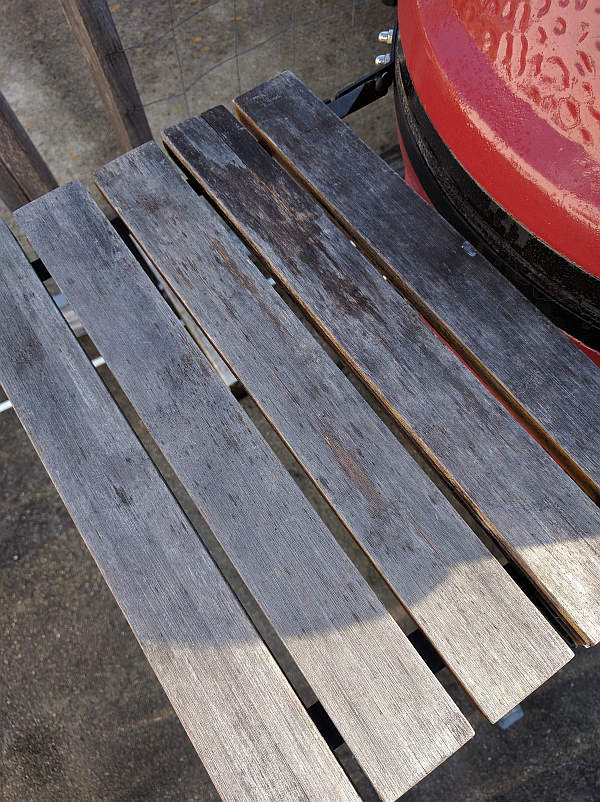 The well worn left side bamboo kamado joe side shelf.